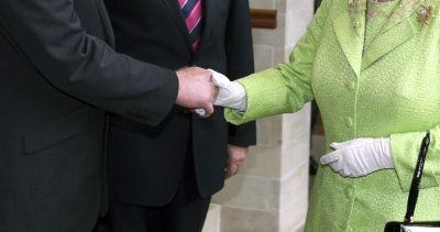 Britain\'s Queen Elizabeth II shakes hand with Sinn Fein Martin McGuinness