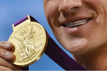 US Swimmer Ryan Lochte smiles over the top with a Paul Wall-inspired grill