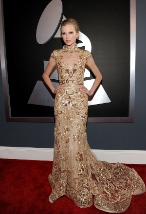 Taylor Swift dazzled in a golden-nude gown at 54th Annual Grammy Awards